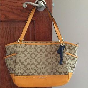 Beautiful fall coach purse.